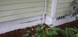 Exterior Stemwall Cracks, Skewed Doorframe, and Interior Wall Cracks