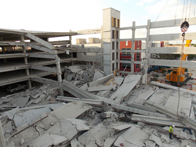 Haag forensic engineers arrived on site of the collapse of a six-story precast concrete parking garage hours after the collapse.