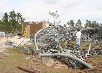 A Haag Engineer examines a collapsed TV/Radio tower structure.
